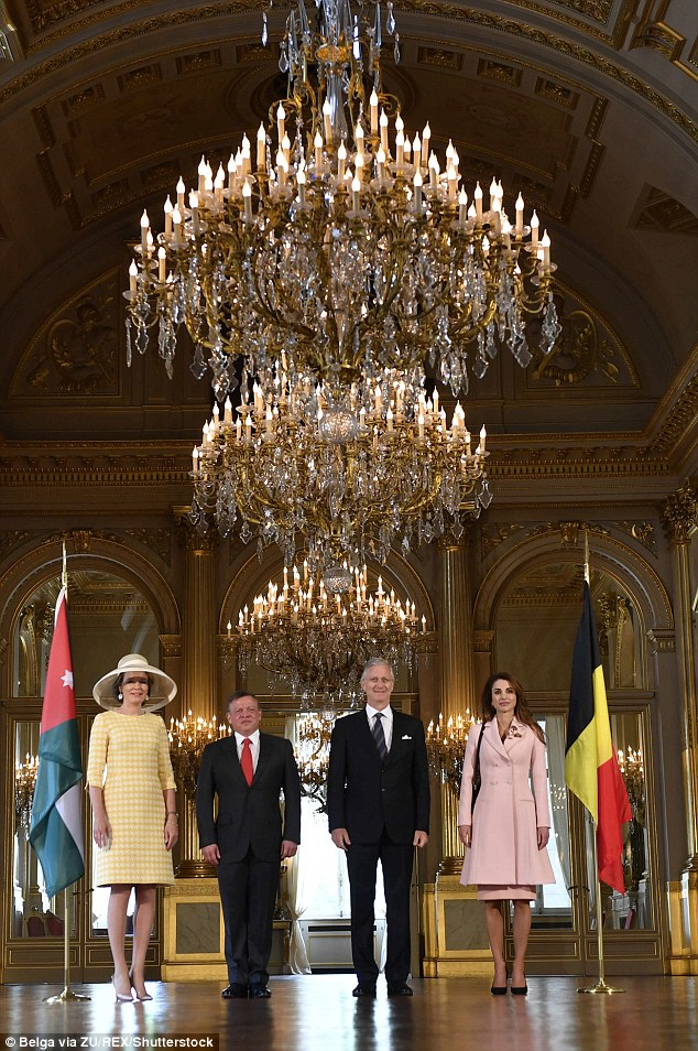 The royals were flanked by the flags of both countries during a reception at the palace in Brussels
