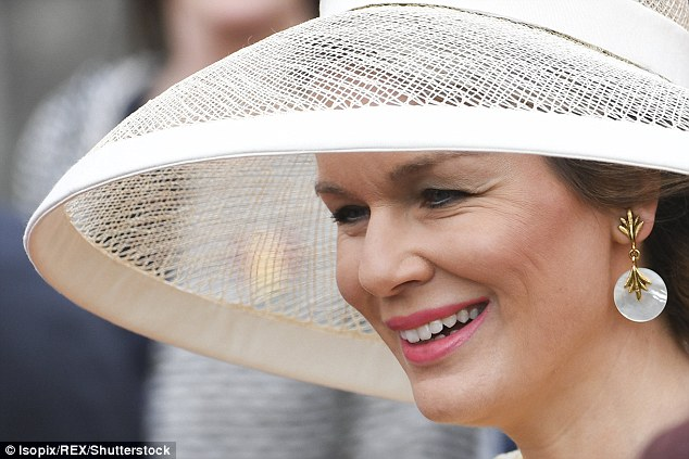Her choice of an extra large hat meant Queen Mathilde ended up with a few logistical difficulties