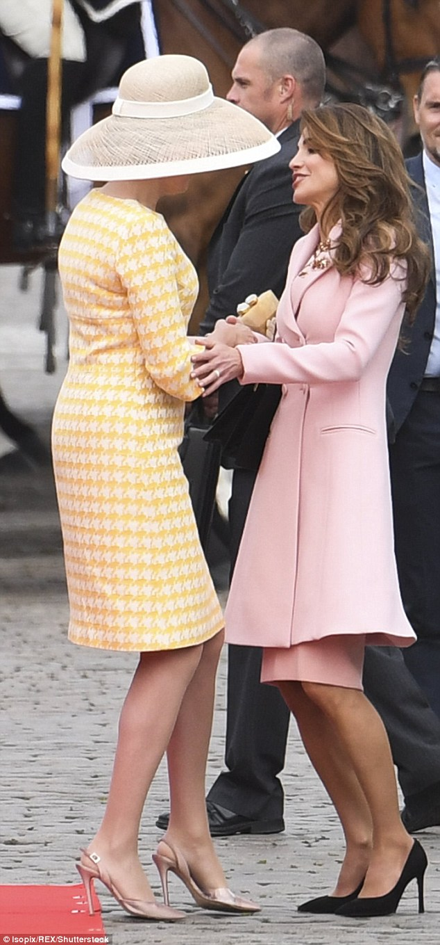 Queen Rania put a friendly hand on her fellow royal's arm as they greeted each other