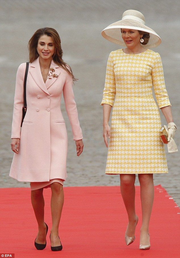 Queen Rania looked elegant in a pink coat with a gold flower embroidered on the left lapel, worn over a dress in a matching shade
