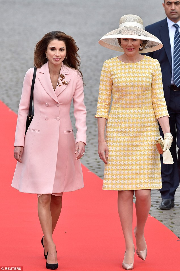 Queen Mathilde and Jordan's Queen Rania during a welcome ceremony outside the Royal Palace in Brussels, Belgium