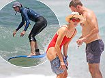 EXCLUSIVE: ** PREMIUM EXCLUSIVE RATES APPLY**  Michelle Monaghan hangs ten in Hawaii. She was seen wearing a red hot bikini and grabbing a smoothie with her husband Peter White.\n\nPictured: Michelle Monaghan and Peter White\nRef: SPL1275888  160516   EXCLUSIVE\nPicture by: Splash News\n\nSplash News and Pictures\nLos Angeles: 310-821-2666\nNew York: 212-619-2666\nLondon: 870-934-2666\nphotodesk@splashnews.com\n