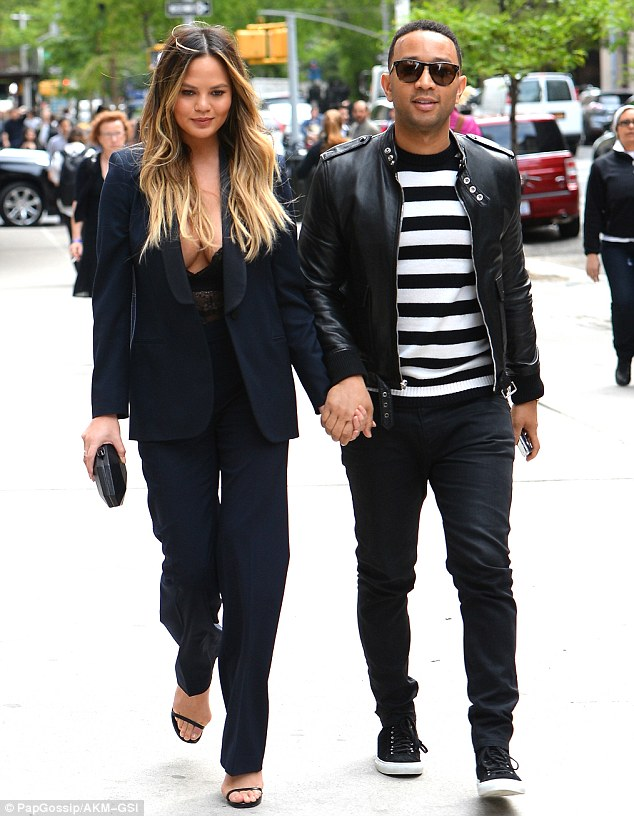 Loved up: The 30-year-old model was joined by her musician husband John Legend