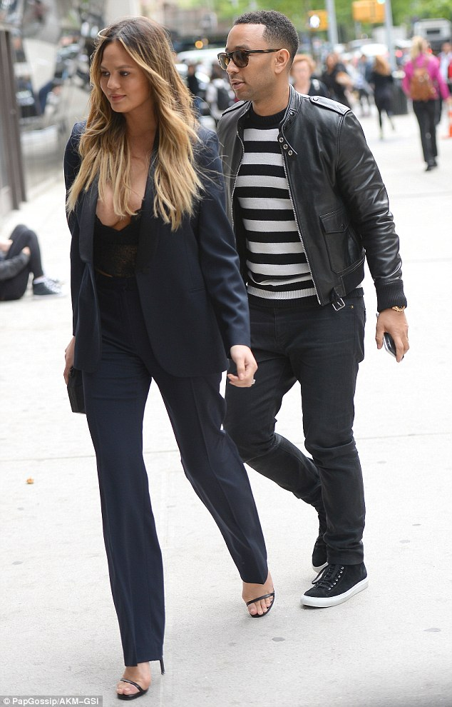 Casual cool: John, 37, looked dapper in a black leather jacket over a black and white striped top, skinny black jeans and black leather sneakers
