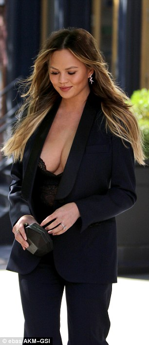 Wow factor: No doubt she gave passersby an eyeful in the low-cut lacy black number