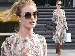 Picture Shows: Rosie Huntington-Whiteley  May 16, 2016\n \n **Min £200 Set Online / Web Usage Fee**\n \n British Model and Designer Rosie Huntington-Whiteley seen leaving the M&S headquarters in London, England. \n \n The English model was dressed in Zimmermann and wearing Jimmy Choo ANDIE/S sunglasses with her Celine belt bag.\n \n **Min £200 Set Online / Web Usage Fee**\n \n Exclusive - All Round\n WORLDWIDE RIGHTS\n \n Pictures by : FameFlynet UK © 2016\n Tel : +44 (0)20 3551 5049\n Email : info@fameflynet.uk.com