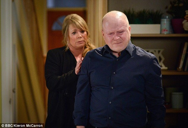 Heartbroken: Left to deal with aftermath of his mother's suicide, an inconsolable Phil breaks down as his wife Sharon attempts to comfort him