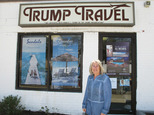 "In this April 6, 2015 photo, Claudia Rabin-Manning stands outside her Baldwin, N.Y. business, Trump Travel. Rabin-Manning says she has been the target of legal action from Republican presidential candidate Donald Trump over the use of the name Trump Travel. She explains the business name has nothing to do with the businessman, and instead was named by a previous owner of the travel agency who played canasta, where the ""trump card"" is used in the game. (AP Photo/Frank Eltman)"