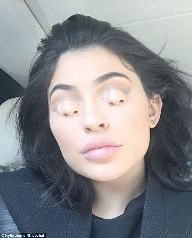 Creepy:The star made sure to SnapChat her time on set which included using a bizarre new filer that put her nose where her eyes should be