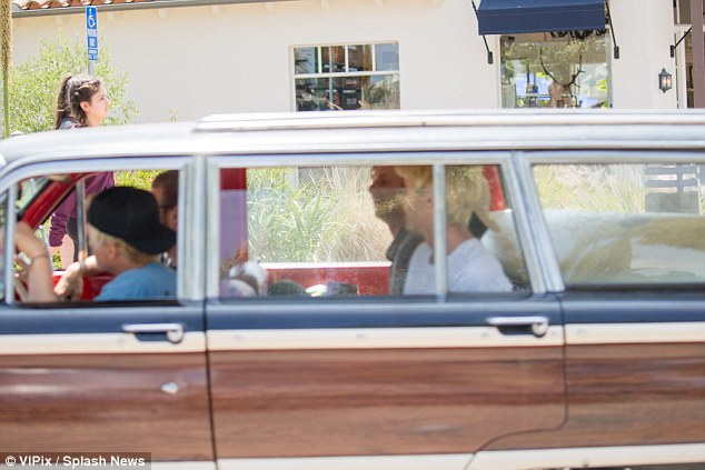 Cruising around: Alli's brother Cody was spotted driving around Malibu with friends on Sunday
