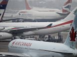 Planes make ready for departure as one plane lands at rear, on the southern runway as disruption continues due to bad weather leading to the cancellation of some flights at London's Heathrow Airport, Wednesday, Dec., 22, 2010. (AP Photo/Alastair Grant)