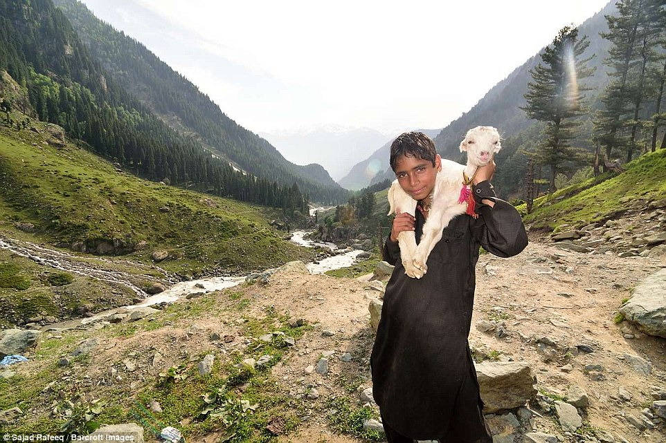 A young boy poses for a picture at Pahalgam Valley. The journeys undertaken by the families for their annual migration can take up to three weeks