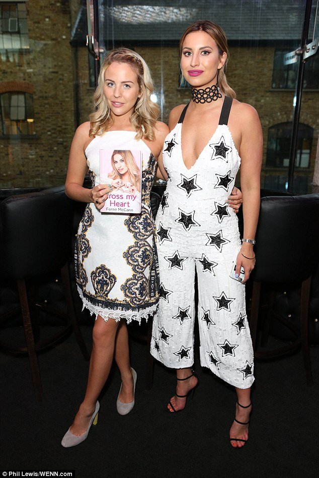 Proud friend: Lydia (L) looked sensational in an intricately embroidered white dress as she posed with Ferne while holding her autobiography