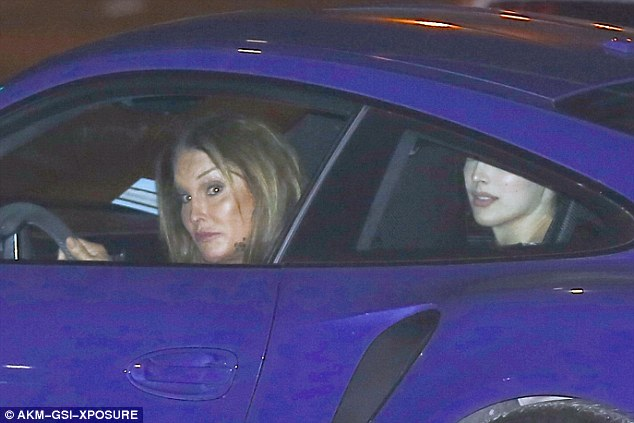 She's made up: The former Olympian sported a full face of make-up as she kept her eyes on the road during the cruise