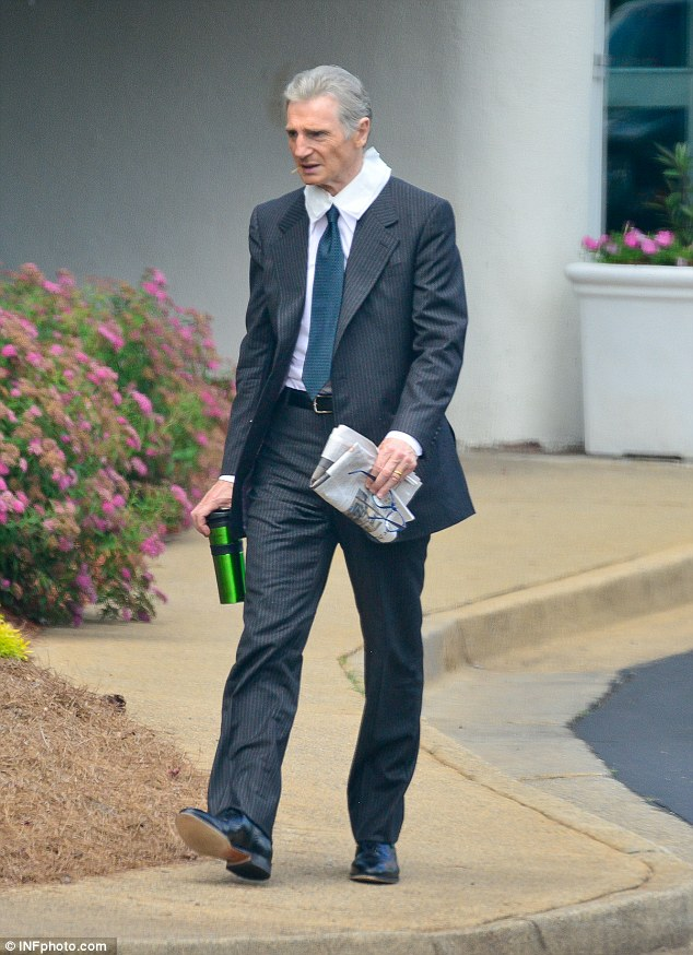 Back in character: Liam Neeson transformed for his latest role in drama Felt on Wednesday as he appeared on the set in Atlanta, GA