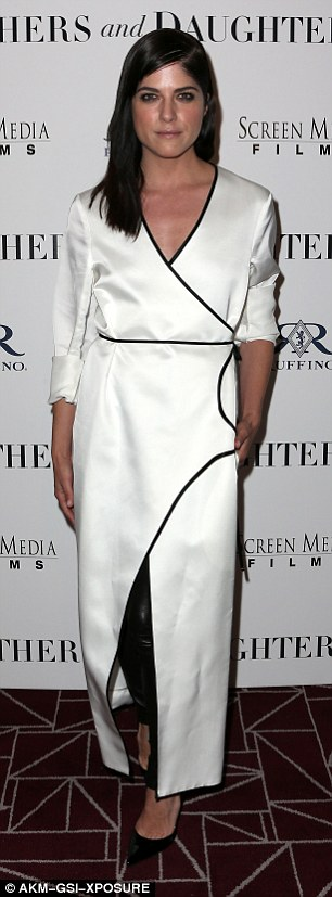 White hot: Selma looked sensational in a stunningwrap-around white satin full-length dress for theMothers And Daughters' Hollywood premiere late last month