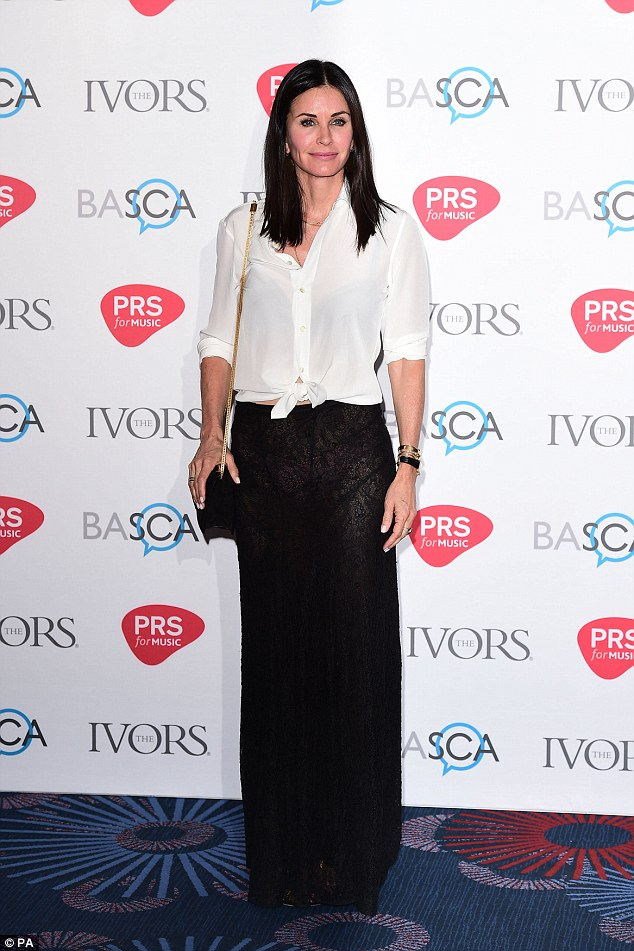 Chic: The brunette beauty, 51, looked chic in the simple ensemble, under more conservative lighting