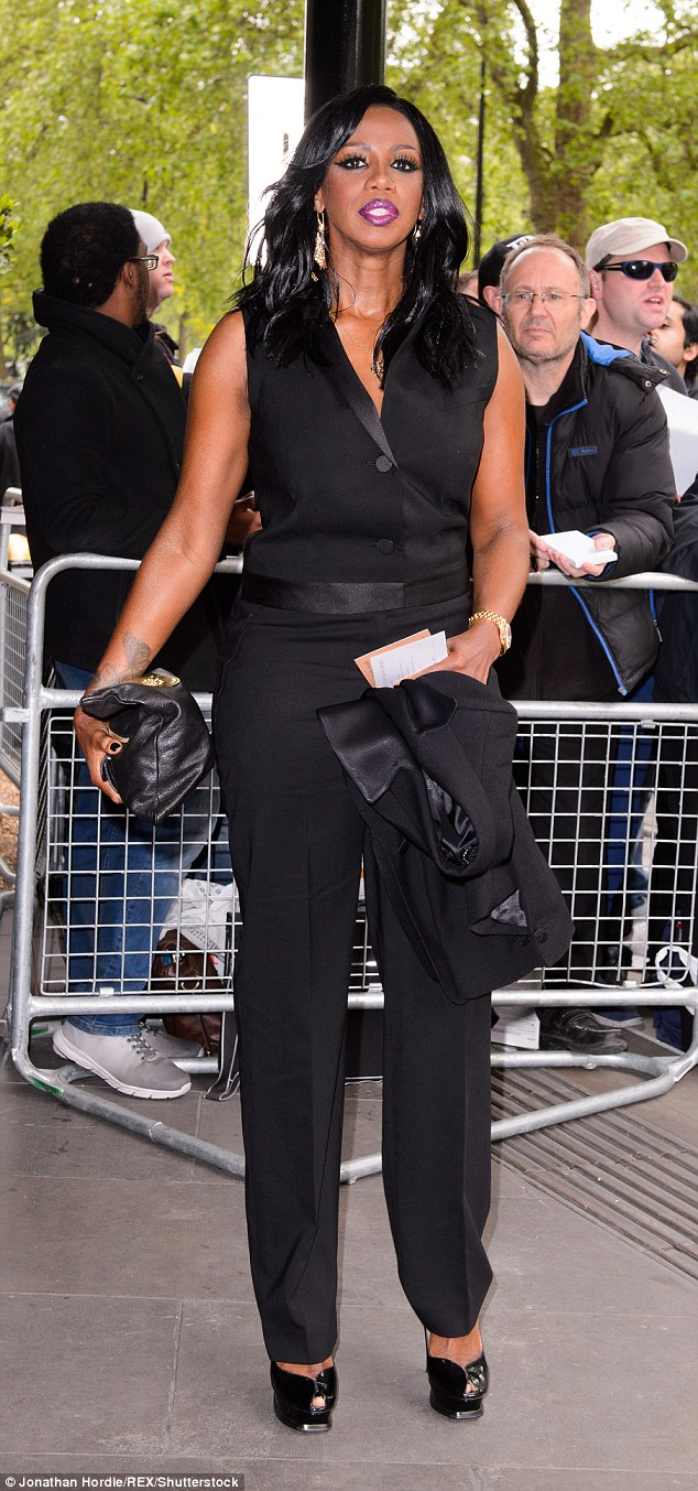 She knows where it's at: All Saints star Shaznay Lewis looked sleek in a black tuxedo jumpsuit and heels