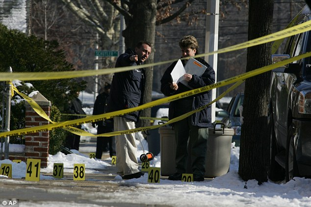 Police investigate the crime scene where off-duty NYPD officer Daniel Enchautegui, 28, was shot and killed on December 10, 2005 while responding to a burglary. Lillo Brancato served time for the burglary and his accomplice Steven Armento is still in prison for firing the shot that killed Enchautegui