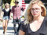 152306, Chloe Moretz and Brooklyn Beckham seen holding hands as they stroll down the street. The pair bought some water at a gas station after visiting a tattoo shop, possibly getting tattoos. Brooklyn could also be seen wearing the same clothes from his airport trip yesterday. Los Angeles, California - Tuesday May 16, 2016. Photograph: © Sam Sharma, PacificCoastNews. Los Angeles Office: +1 310.822.0419 UK Office: +44 (0) 20 7421 6000 sales@pacificcoastnews.com FEE MUST BE AGREED PRIOR TO USAGE