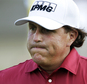 FILE - In this May 29, 2014, file photo, Phil Mickelson reacts after making double bogey on the 17th hole during the first round of the Memorial golf tournament in Dublin, Ohio. The Securities And Exchange Commission is filing a complaint against Mickelson related to insider trading. The SEC says in 2012, high-profile sports bettor Billy Walters called Mickelson, who owed him money, and urged him to trade Dean Foods stock. The SEC says Mickelson did so the next day and made a profit of $931,000.  The SEC says Walters received tips and business information about Dean Foods Co. from former Dean Foods director Thomas Davis between 2008 and 2012.  (AP Photo/Jay LaPrete, File)