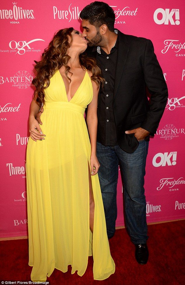Sealed with a kiss: Farrah Abraham smooched boyfriend Simon Saran at the OK! Magazine So Sexy party in West Hollywood on Wednesday