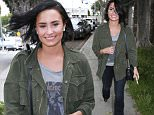 Picture Shows: Demi Lovato  May 18, 2016\n \n Singer Demi Lovato and her bodyguard are seen leaving her office in West Hollywood, California. Demi was in a good mood even taking pictures of the paparazzi as she made her way to the car.\n \n Non Exclusive\n UK RIGHTS ONLY\n \n Pictures by : FameFlynet UK © 2016\n Tel : +44 (0)20 3551 5049\n Email : info@fameflynet.uk.com