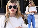 17.May.2016 - Beverly Hills ñ USA\n*** STRICTLY AVAILABLE FOR UK AND GERMANY USE ONLY ***\nBeverly Hills, CA - Sofia Richie stops by Barney's New York for some retail therapy. The 17-year-old model is wearing high waisted denim pants with a long sleeve white shirt paired with sneakers. Sofia's hair has grown out showing a couple inches of her natural color.\nBYLINE MUST READ : AKM-GSI-XPOSURE\n***UK CLIENTS - PICTURES CONTAINING CHILDREN PLEASE PIXELATE FACE PRIOR TO PUBLICATION ***\n*UK CLIENTS MUST CALL PRIOR TO TV OR ONLINE USAGE PLEASE TELEPHONE 0208 344 2007*\n
