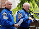 Retired astronaut Scott Kelly, right, speaks while standing next to his astronaut twin brother Mark Kelly during an event renaming the elementary school they attended, Thursday, May 19, 2016, in West Orange, N.J. Pleasantdale Elementary School was renamed the Kelly Elementary School during the ceremony. (AP Photo/Julio Cortez)