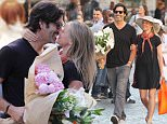 17.MAY.2016 - ROME - ITALY *AVAILABLE FOR UK SALE ONLY* **EXCLUSIVE ALL ROUND PICTURES** ¯American actress Amy Smart and her husband Carter Oosterhouse buy flowers and kiss in the street as they enjoy a romantic holiday in Rome, Italy!   BYLINE MUST READ : CIAOPIX/XPOSUREPHOTOS.COM ***UK CLIENTS - PICTURES CONTAINING CHILDREN PLEASE PIXELATE FACE PRIOR TO PUBLICATION *** **UK CLIENTS MUST CALL PRIOR TO TV OR ONLINE USAGE PLEASE TELEPHONE  44 208 344 2007 ***