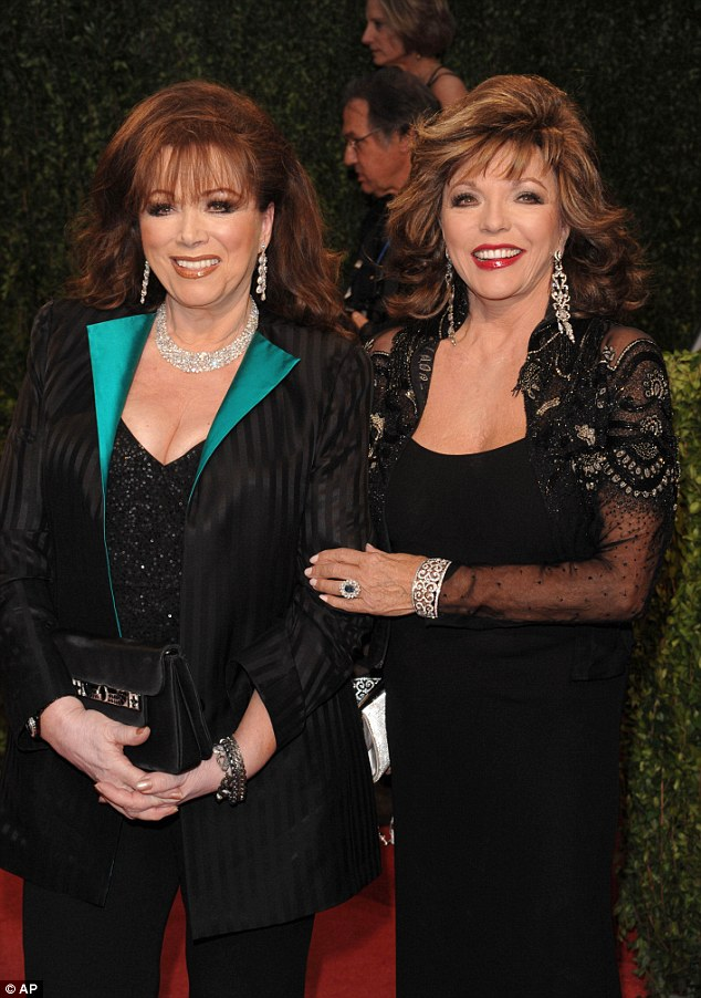 Close bond: Joan is pictured with her younger sister Jackie Collins in 2009. Jackie died last September after a six-year battle with breast cancer