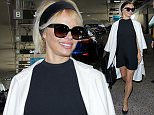 Los Angeles, CA - Pamela Anderson arrives in Los Angeles at LAX on a flight in monochrome after attending the 69th Cannes Film Festival. AKM-GSI    May  17, 2016 To License These Photos, Please Contact : Steve Ginsburg (310) 505-8447 (323) 423-9397 steve@akmgsi.com sales@akmgsi.com or Maria Buda (917) 242-1505 mbuda@akmgsi.com ginsburgspalyinc@gmail.com