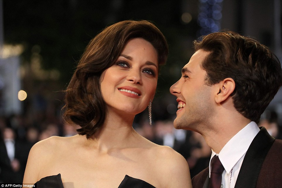 Good times:Canadian director Xavier Dolan and French actress Marion Cotillard pose up a storm at the film's premiere