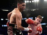 LAS VEGAS, NEVADA - MAY 07:  Canelo Alvarez (R) delivers the knockout punch to Amir Khan during the sixth round of their WBC middleweight title fight at T-Mobile Arena on May 7, 2016 in Las Vegas, Nevada.  (Photo by David Becker/Getty Images) ***BESTPIX***