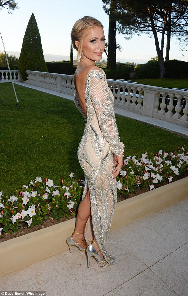 Stunning! Paris hinted at her lithe frame with the silver and nude floor-length dress, her first of the evening