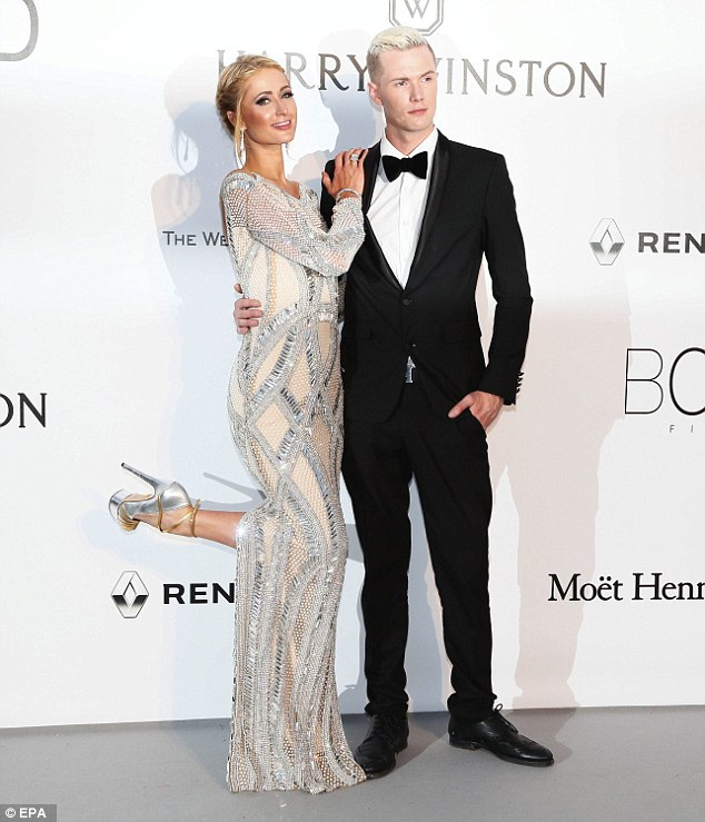 Family bond: The hotel chain heiress was joined for the star-studded event by her brother Barron, 26, who looked dapper in a black suite complete with matching bow tie