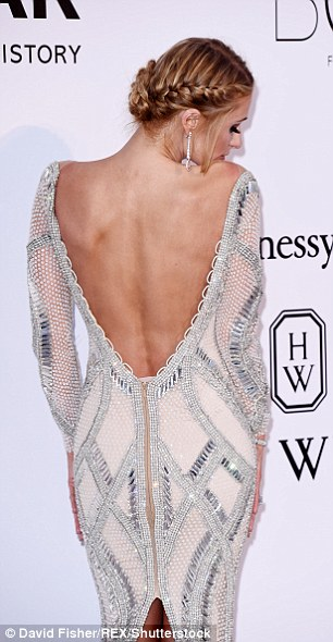 Revealing: The plunging back of the gown revealed plenty of flesh