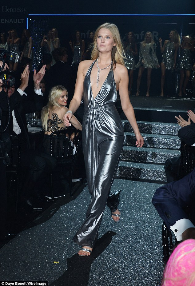 Shimmering: Leonardo DiCaprio's model ex Toni Garrn took the plunge in a low-cut frock that was rather clingy in design