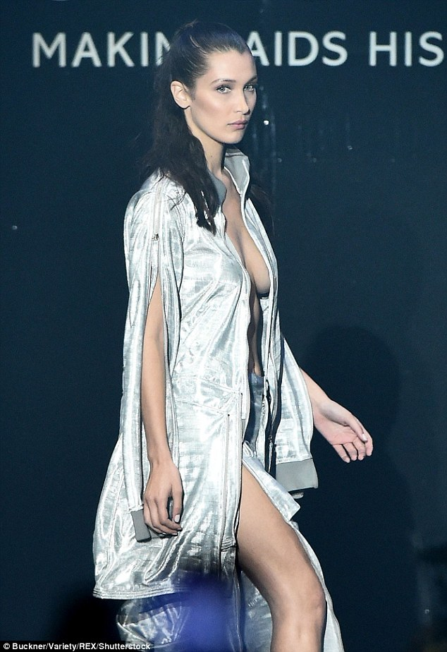 Disco fever: Bella's bust was only protected beneath a silver jacket, which was an outlandish take on a tracksuit top, that was positioned so that it concealed her most intimate parts