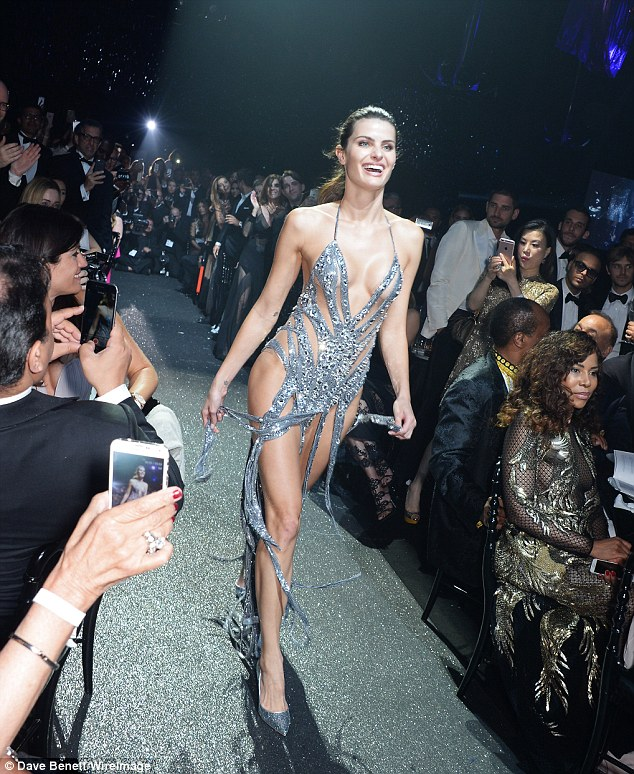Dare to bare: Isabeli Fontana flashed more than a little flesh in a dress that consisted of merely strips of shimmering silver fabric were strategically placed to cover her modesty