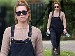 (EXCLUSIVE PICTURES ALL ROUND MINIMUM REPRO £250.00 PER PICTURE) Actress Billie Piper wearing a beige top, dungarees and a pair of Chloe Susanna Studded Leather Buckle Boots spotted out and about in London, UK. 19/05/2016 ..BYLINE MUST READ : JAMESY/GOTCHA IMAGES....Copyright by © Gotcha Images Ltd. All rights reserved...Usage of this image is conditional upon the acceptance ..of Gotcha Images Ltd, terms and conditions available at..www.gotchaimages.com