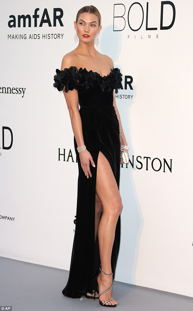 Lady in black: Karlie wowed on the red carpet in an off-the-shoulder Marchesa gown with thigh-high split