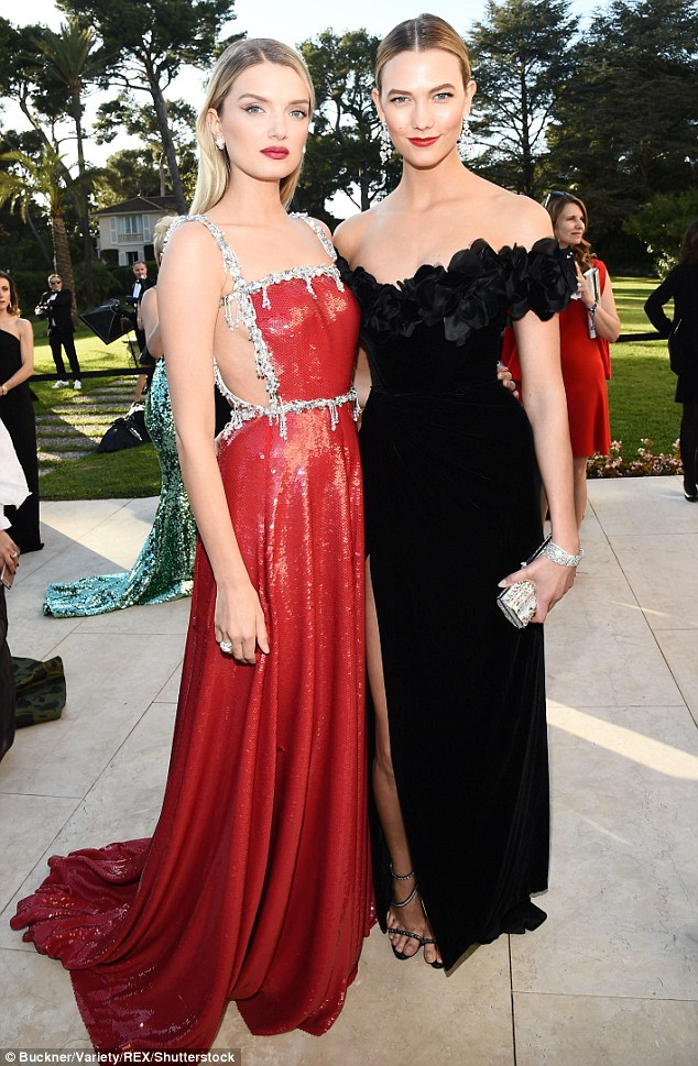 Red alert: Karlie caught up with model pal Lily Donaldson, who looked lovely in a red Miu Miu dress