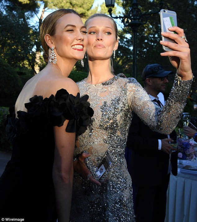 Lemme a take a selfie: Toni and Karlie cosy up for a selfie during the champagne reception