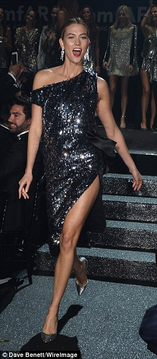 Let's get this party started! Karlie was in high spirits as she showed off one of the Studio 54-inspired fashion collection