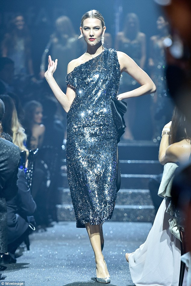 All change: The 23-year-old danced down the catwalk in a blue sequinned asymmetrical number