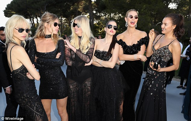 Hilarious: Karlie goofs around in her sunglasses with Soo Joo Park, Doutzen Kroes, Lara Stone, Barbara Palvin and Irina Shayk