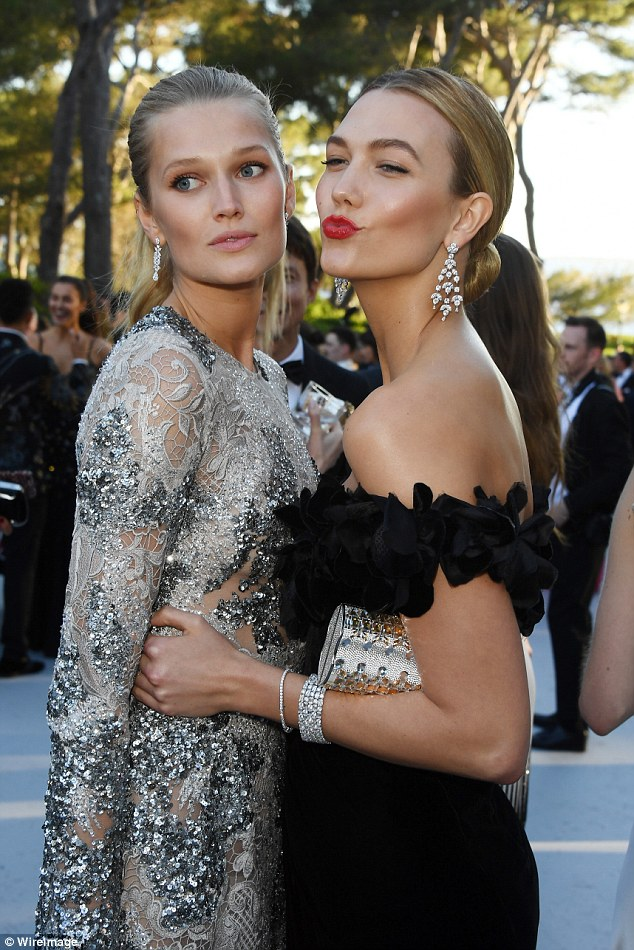 Mwah! Karlie looked thrilled to see her German model friend Toni Garrn