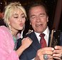 """NBCUNIVERSAL UPFRONT -- ?2016 Upfront Party at MoMA in New York City on Monday, May 16, 2016"""" -- Pictured: (l-r) Miley Cyrus, """"The Voice"""" on NBC; Arnold Schwarzenegger, """"The New Celebrity Apprentice"""" on NBC  -- (Photo by: Theo Wargo/NBCUniversal/NBCU Photo Bank via Getty Images)"""