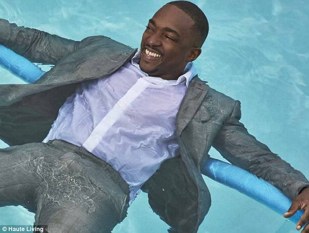 Wild guy! He did show just a glimpse of his crazy side for the publication, as they photographed him floating in a pool after asking him on a whim to jump in fully-clothed in a light grey suit and white shirt